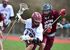 4/23/2016 Mike Orazzi | Staff<br /> Bristol Central's Nick Bouchard (19) and Canton High School's Nicholas Allen (99)during lacrosse Saturday at BCHS.