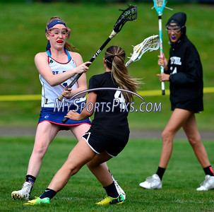 4/22/2016 Mike Orazzi | Staff Bristol Co-op girls lacrosse's Aly Policarpio (4) and and St. Paul Catholic High School's Morgan Moore (1) Friday afternoon in Bristol.