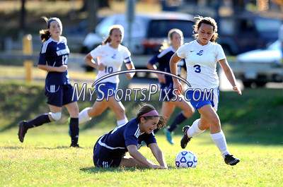 9/23/2016 Mike Orazzi   Staff Bristol Eastern's Jenna Soucy (3) and Wethersfield's Megan Darrell (13) at BEHS Friday.
