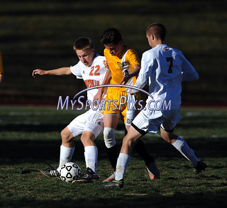 11/8/2016 Mike Orazzi | Staff Terryville's Ethan Rheault (22) and Derek Thibodeau (7) with Thomaston's Marc DiBeneditto (4) during the Class S First Round Soccer Tournament at THS Tuesday.