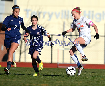 11/11/2016 Mike Orazzi | Staff Terryville's Jenna Covello (2) and Bolton's Emma Lourenco (7) and Leah Hartl (16) during the Class S Quarterfinal girls soccer Friday.
