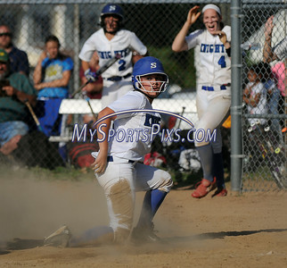 6/2/2016 Mike Orazzi | Staff Southington High School's Madison Rocha (11) safe at home as Darien's Brittany Pierce (7) reaches with the tag during the Class LL Quarterfinals of the CIAC 2016 State Softball Tournament in Southington Thursday.