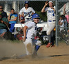 6/2/2016 Mike Orazzi | Staff<br /> Southington High School's Madison Rocha (11) safe at home as Darien's Brittany Pierce (7) reaches with the tag during the Class LL Quarterfinals of the CIAC 2016 State Softball Tournament in Southington Thursday.