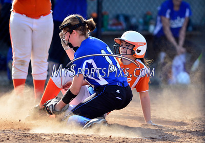 4/21/2016 Mike Orazzi | Staff Terryville High School's Alycia Calabrese (15) scores as Lewis Mills' Mary Cormier (11) covers the plate on Thursday at THS.