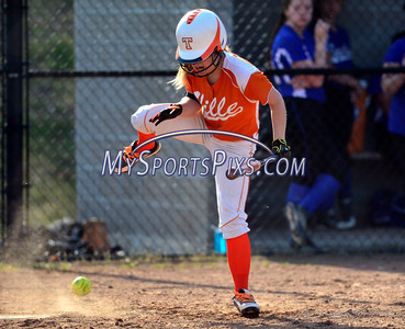 4/21/2016 Mike Orazzi   Staff Terryville High School's Ariana Katiewicz (1) gets his by a pitch on Thursday.