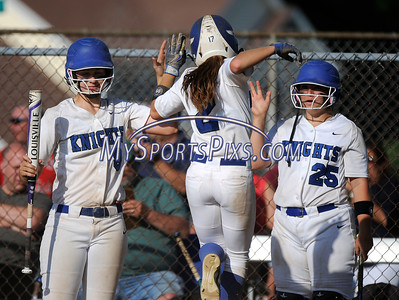 6/2/2016 Mike Orazzi | Staff Southington High School's Delaney Picard (9) Michelle Woodruff (2) and Ellen Scafariello (25) during the Class LL Quarterfinals of the CIAC 2016 State Softball Tournament in Southington Thursday.