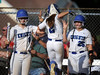 6/2/2016 Mike Orazzi | Staff<br /> Southington High School's Delaney Picard (9) Michelle Woodruff (2) and Ellen Scafariello (25) during the Class LL Quarterfinals of the CIAC 2016 State Softball Tournament in Southington Thursday.