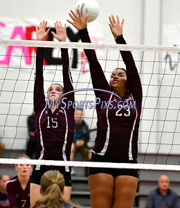 10/26/2016 Mike Orazzi | Staff Bristol Central's Andreia DeAngelo (15) and Xia'ian Carrasco (23) during Wednesday night's match with Bristol Eastern.