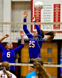 9/20/2016 Mike Orazzi | Staff St. Paul volleyball's Bianca DiLernia (6) and Rachel Castertano (25)  at Torrington High School Tuesday night.