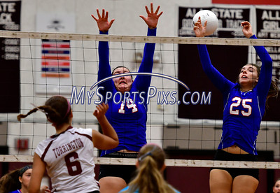 9/20/2016 Mike Orazzi | Staff St. Paul volleyball's Julianna Iacovelli (14) and Rachel Castertano (25) and Torrington High School's Carissa Carbone (6) Tuesday night.