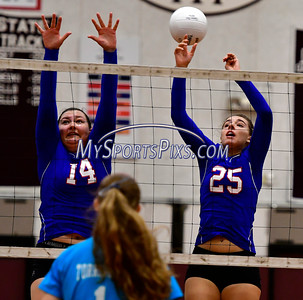 9/20/2016 Mike Orazzi | Staff St. Paul volleyball's Julianna Iacovelli (14) and Rachel Castertano (25) at Torrington High School Tuesday night.