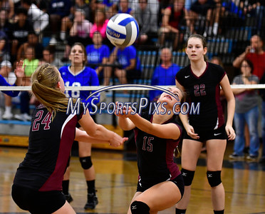 10/19/2016 Mike Orazzi | Staff Farmington's Caroline Cullen (24) and Ali Troup (15) during Wednesday nights volleyball match in Bristol.