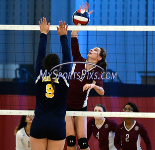 11/3/2016 Mike Orazzi   Staff Innovation's Bailee Nardi (3) and HMTCA's  Jada Ortiz (9) during the CRAL Volleyball Championship Thursday in New Britain.