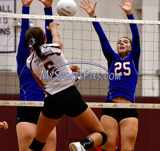 9/20/2016 Mike Orazzi | Staff St. Paul volleyball's Rachel Castertano (25)  and Torrington High School's Carissa Carbone (6) Tuesday night.