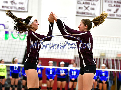 10/26/2016 Mike Orazzi | Staff Bristol Central's Brianna Saverino (5) and Andreia DeAngelo (15) during Wednesday night's match with Bristol Eastern.