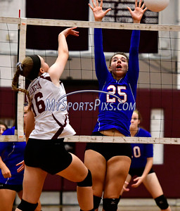 9/20/2016 Mike Orazzi | Staff St. Paul volleyball's Rachel Castertano (25)  and Torrington High School's Lauren Gaghan (16) Tuesday night.