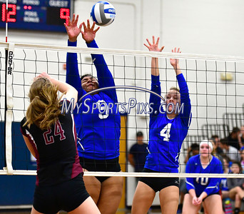 10/19/2016 Mike Orazzi | Staff Bristol Eastern's Sienna White (9) and Olivia Beaudoin (4) with Farmington's Caroline Cullen (24)during Wednesday nights volleyball match in Bristol.