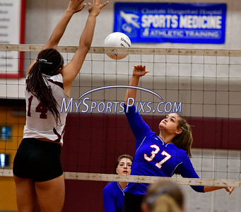 9/20/2016 Mike Orazzi | Staff St. Paul volleyball's Katelynn Ouelette (37) and Torrington High School's Jolie Fox (14) Tuesday night.