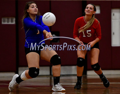 9/20/2016 Mike Orazzi | Staff St. Paul volleyball's Lizzie Darragiati (1) and Emma McPhee (15) at Torrington High School Tuesday night.