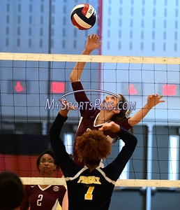 11/3/2016 Mike Orazzi   Staff Innovation's Bailee Nardi (3) and HMTCA's Bashara Samuda (7) during the CRAL Volleyball Championship Thursday in New Britain.