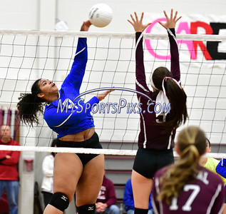 10/26/2016 Mike Orazzi | Staff Bristol Eastern's Sienna White (9) and Bristol Central's  Brianna Saverino (5) during Wednesday night's volleyball match at Central.
