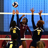 11/3/2016 Mike Orazzi | Staff<br /> Innovation's Kimberly Okeke (5) and HMTCA's Jada Ortiz (9) and Bashara Samuda (7) during the CRAL Volleyball Championship Thursday in New Britain.
