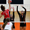 10/4/2016 Mike Orazzi | Staff<br /> Northwestern's Molly Porch (5) and Terryville's Alycia Calabrese (15) and Martina Trovato (7).