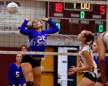 9/20/2016 Mike Orazzi | Staff St. Paul volleyball's Rachel Castertano (25)  and Torrington High School's Nica Lestrud (26) Tuesday night.
