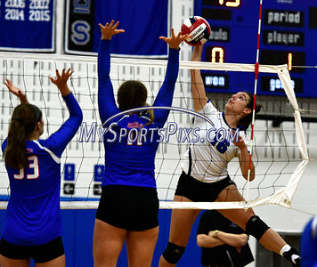 11/2/2016 Mike Orazzi | Staff Southington's Morgan Raymond (16) and Tolland High School's Annie Geitner (33) and Jordyn Dube (11) during the CCC Volleyball Tournament.