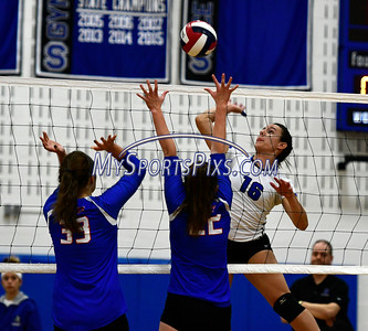 11/2/2016 Mike Orazzi | Staff Southington's Morgan Raymond (16) and Tolland High School's Steph Wilson (32) and Kelly Scheidel (22) during the CCC Volleyball Tournament.