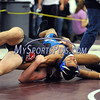 2/20/2016 Mike Orazzi | Staff<br /> Bristol Eastern's Michael and E.O. Smith Isaiah Rivera in a 152 during the Class L State Tournament at Bristol Central Saturday morning.