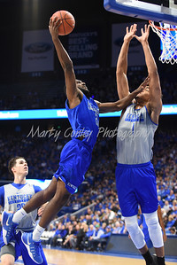 Dominique Hawkins goes up strong to the basket against Sacha Killeya-Jones on Saturday during the UK Blue-White game.  MARTY CONLEY/ FOR THE DAILY INDEPENDENT