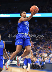 Malik Monk lofts the ball in the basket on Saturday during the UK Blue-White game in Lexington.  MARTY CONLEY/ FOR THE DAILY INDEPENDENT