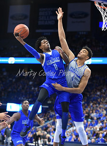 De'Aaron Fox goes up strong the basket as Sacha Killeya-Jones defends during the UK Blue-White game.  MARTY CONLEY/ FOR THE DAILY INDEPENDENT