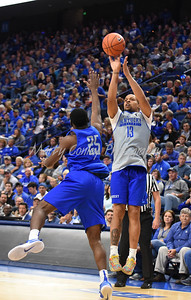 Isaiah Briscoe shoots a jump shot over Dominique Hawkins on Saturday evening during the UK Blue-White game.  MARTY CONLEY/ FOR THE DAILY INDEPENDENT