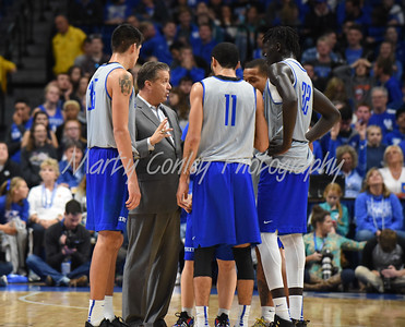 Kentucky head basketball coach, John Calipari talks with the White team during a timeout on Saturday during the UK Blue-White game.  MARTY CONLEY/ FOR THE DAILY INDEPENDENT