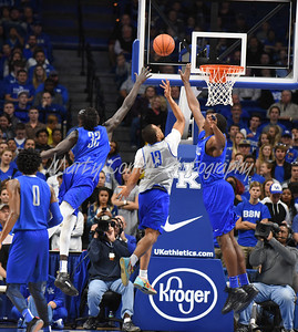 Isaiah Briscoe splits the defense of Wenyen Gabriel and Bam Adebayo on Saturday during the UK Blue-White game.  MARTY CONLEY/ FOR THE DAILY INDEPENDENT