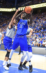 Wenyen Gabriel fights for position on Saturday evening during the UK Blue-White game in Lexington.  MARTY CONLEY/ FOR THE DAILY INDEPENDENT