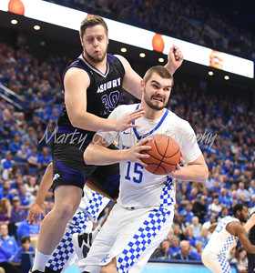 Isaac Humphries of Kentucky battles Jared Farris of Asbury for a rebound on Sunday evening.  MARTY CONLEY/ FOR THE DAILY INDEPENDENT