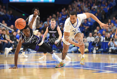 Kentucky's Isaiah Briscoe and Asbury's Bushe Ramabu fight for a loose ball on Sunday evening in Lexington.  MARTY CONLEY/ FOR THE DAILY INDEPENDENT