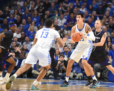 Kentucky's Derek Willis makes a pass to Isaiah Briscoe on Sunday evening against Asbury.  MARTY CONLEY/ FOR THE DAILY INDEPENDENT
