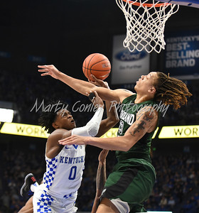 Kentucky's De'Aaron Fox puts up the hard shot against Cleveland State's Jamarcus Hairston on Wednesday.  MARTY CONLEY/ FOR THE DAILY INDEPENDENT