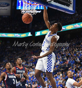 Malik Monk of Kentucky throws down a slam dunk on Sunday night against Duquesne.  MARTY CONLEY/ FOR THE DAILY INDEPENDENT