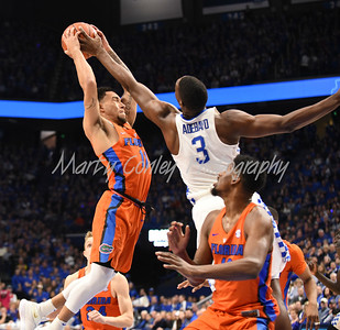 Bam Adebayo of Kentucky contests Florida's Chris Chiozza on Saturday afternoon.  MARTY CONLEY/ FOR THE DAILY INDEPENDENT