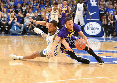 Isaiah Briscoe of Kentucky and Brandon Sampson of LSU battle for the loose ball on Tuesday evening.  MARTY CONLEY/ FOR THE DAILY INDEPENDENT