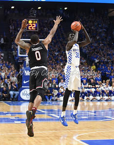 Kentucky's Wenyen Gabriel shoots a long jumper on Saturday as South Carolina's Sindarius Thornwell applies pressure.  MARTY CONLEY/ FOR THE DAILY INDEPENDENT