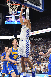 Kentucky's Derek Willis dunks as UCLA's Thomas Welch watches on Saturday at Rupp Arena.  MARTY CONLEY/ FOR THE DAILY INDEPENDENT