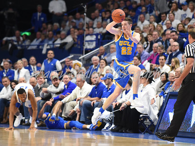 UCLA's TJ Leaf attempts to keep the basketball inbounds on Saturday against Kentucky.  MARTY CONLEY/ FOR THE DAILY INDEPENDENT