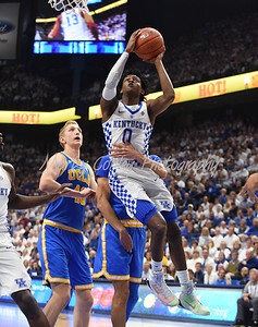 Kentucky's De'Aaron Fox gets wrapped up on a layup Saturday afternoon against UCLA.  MARTY CONLEY/ FOR THE DAILY INDEPENDENT