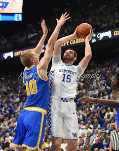 Isaac Humphries of Kentucky battles UCLA's Thomas Welsh in the paint on Saturday.  MARTY CONLEY/ FOR THE DAILY INDEPENDENT